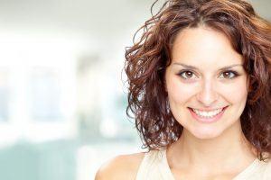 beautiful brunette girl smile portrait in a interior background